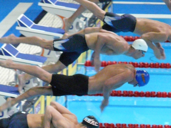 ryan lochte blue cap and michael phelps to his right leave the starting blocks for finals 400im